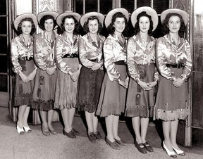In 1942 Eaton's elevator operators were decked out in their finest western duds.  I guess cowboy boots weren't part of the look!  Herald file photo.