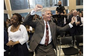 Gregg Saretsky, president and CEO of WestJet, dances at the company's annual general meeting of shareholders in Toronto on Tuesday, May 6, 2014. THE CANADIAN PRESS/Darren Calabrese