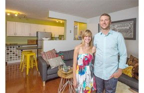 First-time home buyer Mark Kolentsis, and girlfriend Stephanie McLean in their new condo in Calgary.