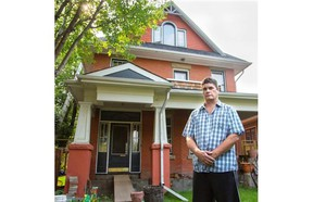 """Greg Pearcey stands outside the century-old home in Elbow Park he purchased in 2010 as a """"fixer-upper."""""""