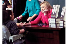 Hillary Clinton meets a woman before signing a copy of her new book at a Barnes and Noble bookstore in New York.