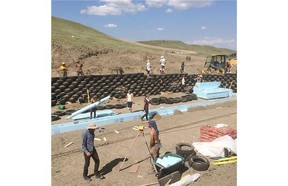 """The Kinney family is building what is believed to be Alberta's first earthship on rural land near Lethbridge. More than 800 tires and 12,000 cans are being used to construct the 1,800 square foot three-bedroom off-the-grid home. Once complete, the Kinney earthship will treat and recycle its greywater, generate its own electricity, produce a portion of its own food and regulate its own temperature. Michael Reynolds, an American architect and the """"father"""" of earthships, is helping build the Alberta project."""
