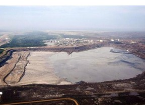 A tailings pond is picture at ythe Syncrude oilsands facility seen from a helicopter near Fort McMurray, Alta.