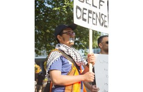 Pro-Palestinian supporters gathered again at City Hall for a silent protest in Calgary on Friday, Aug. 1, 2014.