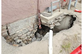 A sink hole caused by last June's flood has expanded under a building that used to house Vespucci Consignment Inc. in High River, threatening the integrity of the structure.