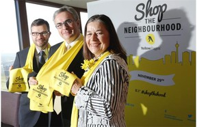 Adam Legge, president and chief executive of the Calgary Chamber of Commerce, left, Julien Billot, president and chief executive of Yellow Pages and Annie MacInnis, chair of Calgary's Business Revitalization Zones during the launch of Shop The Neighbourhood in Calgary.