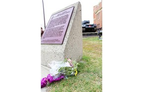 A bouquet of flowers rests outside Calgary's Mewata Armoury on Wednesday.