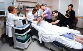 The Calgary Stroke Team assesses a patient emergently at the bedside. With stroke, every minute matters. Image courtesy the Canadian Stroke Network.