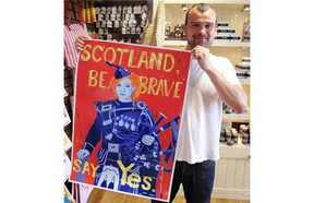 Shop owner Stewart Cattanach holds up posters he´s been printing from inside his Tobermory handmade soap shop. Cattanach says he supports secession to ensure Scotland remains integrated into the European Union. (Courtesy, Jacob Resneck/Calgary Herald)