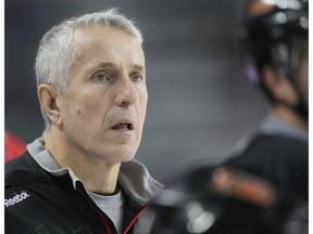 CALGARY, AB.; NOVEMBER 12, 2014  -- Calgary Flames coach Bob Hartley watches his troops during practice Wednesday November 12, 2014 at the Saddledome. (Ted Rhodes/Calgary Herald) For Sports story by Kristen Odland