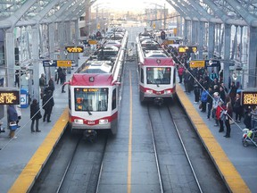 Commuters at the City Hall CTrain station on November 4, 2014.