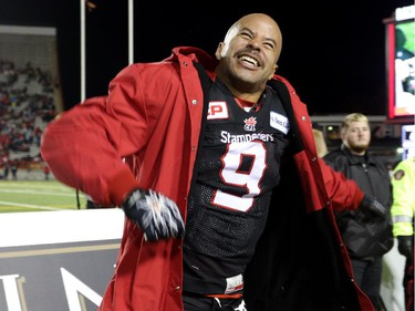 Calgary Stampeders Jon Cornish celebrates after the Stampeders win the West Final against the Edmonton Eskimos at McMahon Stadium in Calgary.