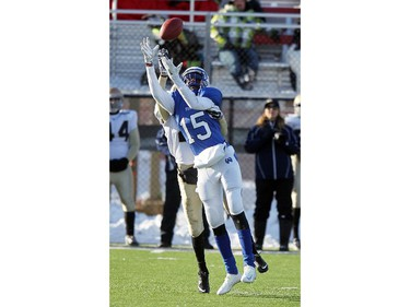 Titans receiver Ronnie Oling has a Pride player on his back as he catches the ball as the Notre Dame Pride played host to the Harry Ainlay Titans in Tier I Provincial semifinal action on November 15, 21014.The Pride won 34 to 14.