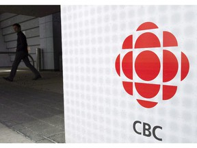 A man leaves the CBC building in Toronto, April 4, 2012.
