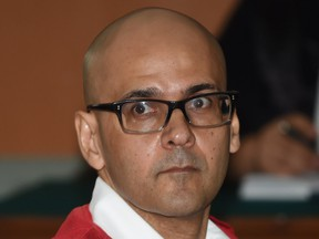 Canadian teacher Neil Bantleman sits inside a court room while waiting for his trial on Dec. 2.