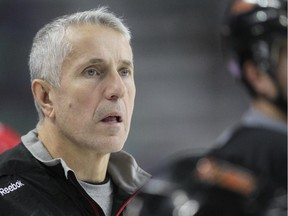 Calgary Flames coach Bob Hartley watches his troops during practice in this file photo.