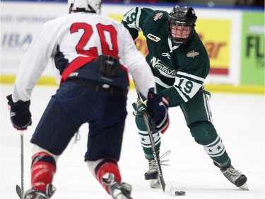 Calgary Northstars forward Adam Tisdale carried the puck towards Lethbridge Hurricanes forward Graham Dugdale during their Mac's AAA Midget Tournament at Max Bell Arena on December 27, 2014.