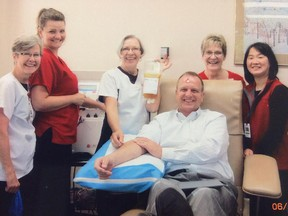 Provincial Court Judge Mark Tyndale is shown with Canadian Blood Services staff on June 4, 2013, when he donated blood for 800th time. In December 2013, Tyndale went to hospital and had emergency surgery for flesh-eating disease and likely was given some fluids including his own donated plasma to help save his life.