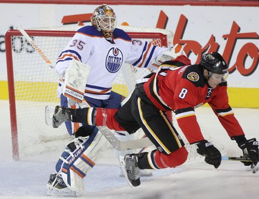 Calgary Flames Joe Colborne, right, collides with Edmonton Oilers goalie Viktor fasth during first period action at the Scotiabank Saddledome in Calgary on December 27, 2014.