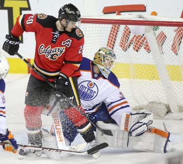Calgary Flames Curtis Glencross and Edmonton Oilers goalie Ben Scrivens during third period action at the Scotiabank Saddledome in Calgary.