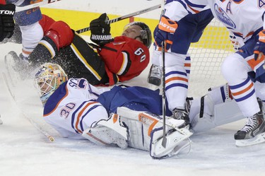Edmonton Oilers goalie Ben Scrivens collides with Calgary Flames Markus Granlund during third period action at the Scotiabank Saddledome in Calgary.