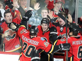 Sean Monahan of the Calgary Flames celebrates with teammates after scoring the winner in overtime against the Colorado Avalanche at the Saddledome on Thursday.