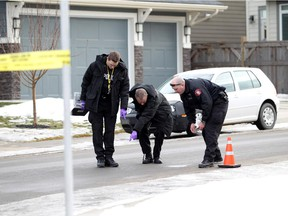Police are investigating a suspicious death after a man was found dead on an Auburn Bay street following reports of gunfire.