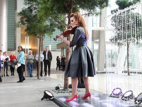 Renowned violinist Sophie Serafino performs a three song pop up concert over the noon hour Thursday January 29, 2015 at the Fifth Avenue Place atrium. A native of Australia she now lives in Calgary. The performance was a preview of her debut performance of The Crystal Violin February 7 at Royal Oak Audi.
