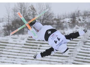Simon Pouliot-Cavanagh of Canada competes for a second place finish at the Freestyle moguls skiing 2015 World Cup at Canada Olympic Park in Calgary, on January 3, 2015.