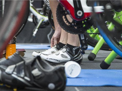 Martin Dodd, organizer of the third annual CANSuffer to Conquer event, adjusts his shoes before riding a stationary bike for 24 hours to raise money for the fight against cancer at the Southcentre Mall in Calgary, on February 28, 2015.