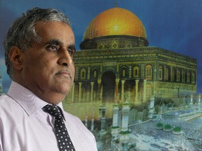Atthar Mahmoud, vice -president of the Islamic Supreme Council of Canada, stands beside a painting of the Al-Aqsa Mosque in Jerusalem in his S.W. Calgary home Thursday, February 12, 2015.