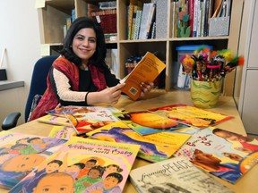 Rahat Naqvi, associate professor of language and diversity education at the U of C, promotes books with bilingual features.