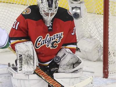 Calgary Flames goalie Karri Ramo, makes a save during the dying minutes of the third period to keep his team up 3-2 against the Vancouver Canucks at the Saddledome in Calgary, on February 14, 2015.