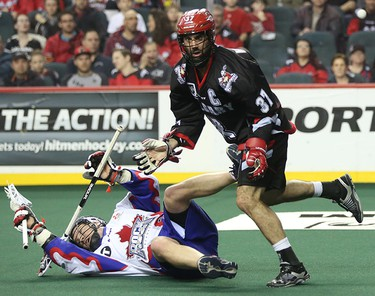 Calgary Roughneck Andrew Mcbride, right, blows over his competition at the Scotiabank Saddledome in Calgary on Saturday, March 28, 2015. The Calgary Roughnecks lost to Toronto Rock, 10-12, in regular season National Lacrosse League play.