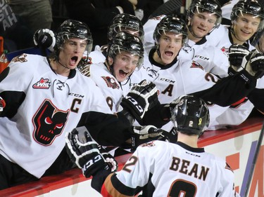 The Calgary Hitmen celebrate Jake Bean's goal in the closing minute of the first period against the Kootenay Ice. The game was the first in a best-of-seven playoff series against the Ice on Friday March 27, 2015.