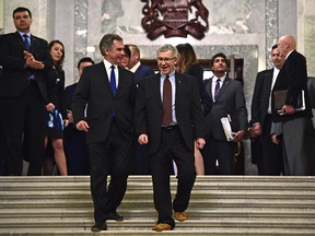 Premier Jim Prentice and Finance Minister Robin Campbell after seen after tabling the 2015 budget Thursday. Reader says the budget missed the mark.