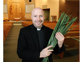 Father Jerome Lavigne of St. Peter's Roman Catholic Church holds palm fronds in advance of Palm Sunday at the church Monday March 23, 2015.