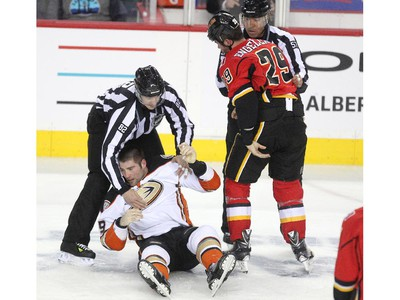 Calgary Flames defenceman Deryk Engelland looked down after decking Anaheim Ducks left winger Patrick Maroon in a fight near centre ice during first period NHL action at the Scotiabank Saddledome on March 11, 2015.
