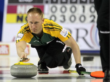 Northern Ontario skip Brad Jacobs slid out of the hack while delivering his final shot of the game against New Brunswick during the Wednesday morning draw of the Tim Horton's Brier at the Scotiabank Saddledome on March 4, 2015.