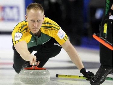 Northern Ontario skip Brad Jacobs delivers his rock into the hands of his sweepers during his Sunday afternoon match against BC at the Tim Hortons Brier at the Scotiabank Saddledome on March 1, 2015.