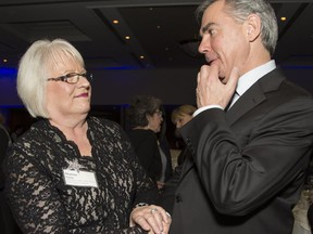 Sharon Carry, CEO and president of Bow Valley College, talks with Premier Jim Prentice at WXN Canada's Most Powerful Women: Top 100 Awards, at the Westin in Calgary, on March 4, 2015.