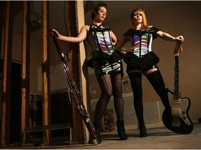 Sidney York band members Krista Wodelet, left, and Brandi Sidoryk will be debuting their new album at the makeFashion at Telus Spark on Saturday. They're wearing the special outfits that were created for them by designer Angela Dale in collaboration with programmer Dan Damron.