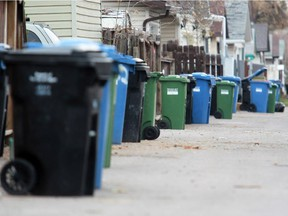An array of garbage, compost and recycling bins in Abbeydale. Each of them are subject to city inspection.