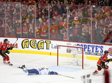 Calgary Flames forward Jiri Hudler, right, celebrates his goal on the empty Vancouver Canucks net during Game 6.