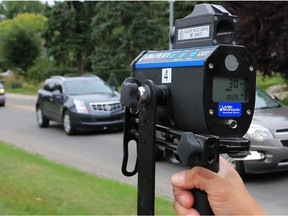 File phot: Police use photo radar to monitor motorists in a playground zone on 8th Avenue S.W., next to Earl Grey Elementary School. Reader would welcome more policing of residential areas and playground zones.