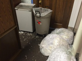 Bags of shredded documents lay outside the offices of the environment ministry. Also moving  carts were lined up in the halls following the election which saw the Tories lose power after 44 years. Reader says it was Jim Prentice's duty, not Rachel Notley's, to stop the shredding.