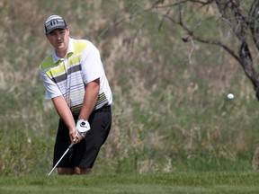 Nick Chomack eyes a chip during the final of the Calgary Golf Association's City Match Play Championship at Sirocco Golf Club on Sunday. He beat Jason Weightman 1-up by sinking an eight-foot birdie putt on No. 18.