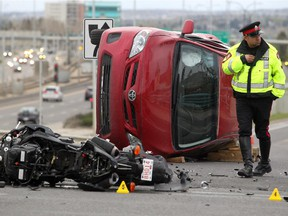 Members of the Calgary Police Service's traffic section investigate a motorcycle accident on 32nd Avenue N.W. over Crowchild Trail on May 7, 2015.
