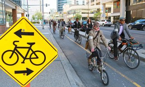 Participants in Calgary's annual Tweed Ride cycle along the 7th street cycle track in downtown Calgary on Monday May 18, 2015. Gavin Young/Calgary Herald)  (For City section story by Emma McIntosh) Trax# 00065372A
