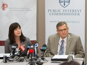 Jill Clayton, left, the Information and Privacy Commissioner, and Peter Hourihan, the Public Interest Commissioner, during a news conference to about a joint investigation into  the alleged improper destruction of records by the Ministry of Environment and Sustainable Resource Development.